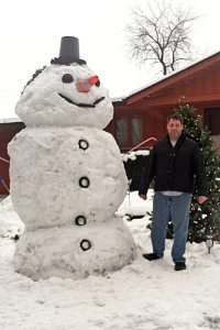 "2014 Community Snow Sculpting winner, Joe Newcomer of Rockford, Illinois with ""Frosty"""